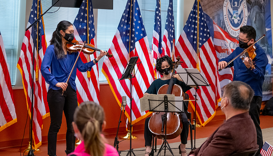 Orchestra musicians performing at a naturalization ceremony